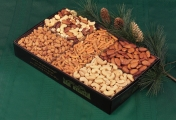 <h5>#1 - Premium Gift Box $49.95*</h5><p>An impressive assortment of Premium Whole Cashews, Roasted Extra Large Almonds, Honey Roasted Peanuts, Delight Mix and New Orleans Mix. Only the very finest available nuts are packaged in our black, gold-embossed gift box to impress the most discriminating recipient. Gift #1 contains a minimum of 3lb 7oz (1.56kg) of edible product. SKU:   (GIF00001)    *$49.95 plus $3.00 handling per gift and $12.65 USPS Priority Mail within the U.S.A.  The accompanying greeting card will be included in the package and the price includes mail tracking and up to $50 insurance.  Contact us for out of the U.S.A. postage prices.</p>