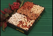 <h5>#2 - Premium Gift Box $57.95*</h5><p>Premium Whole Cashews, Roasted Almonds, Deluxe Mix, California Natural Pistachios and Pecan Brittle. Only the very finest available nuts and brittle are packaged in our black, gold-embossed gift box to impress the most discriminating recipient. Gift #2 contains 3lb 4oz (1.47kg) of edible product.  SKU:   (GIF00002)   *$57.95 plus $3.00 handling per gift and $12.65 USPS Priority Mail within the U.S.A.  The accompanying greeting card will be included in the package and the price includes mail tracking and up to $50 insurance.  Contact us for out of the U.S.A. postage prices.</p>